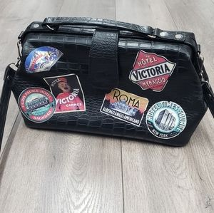 Vintage style black doctor bag w travel stickers